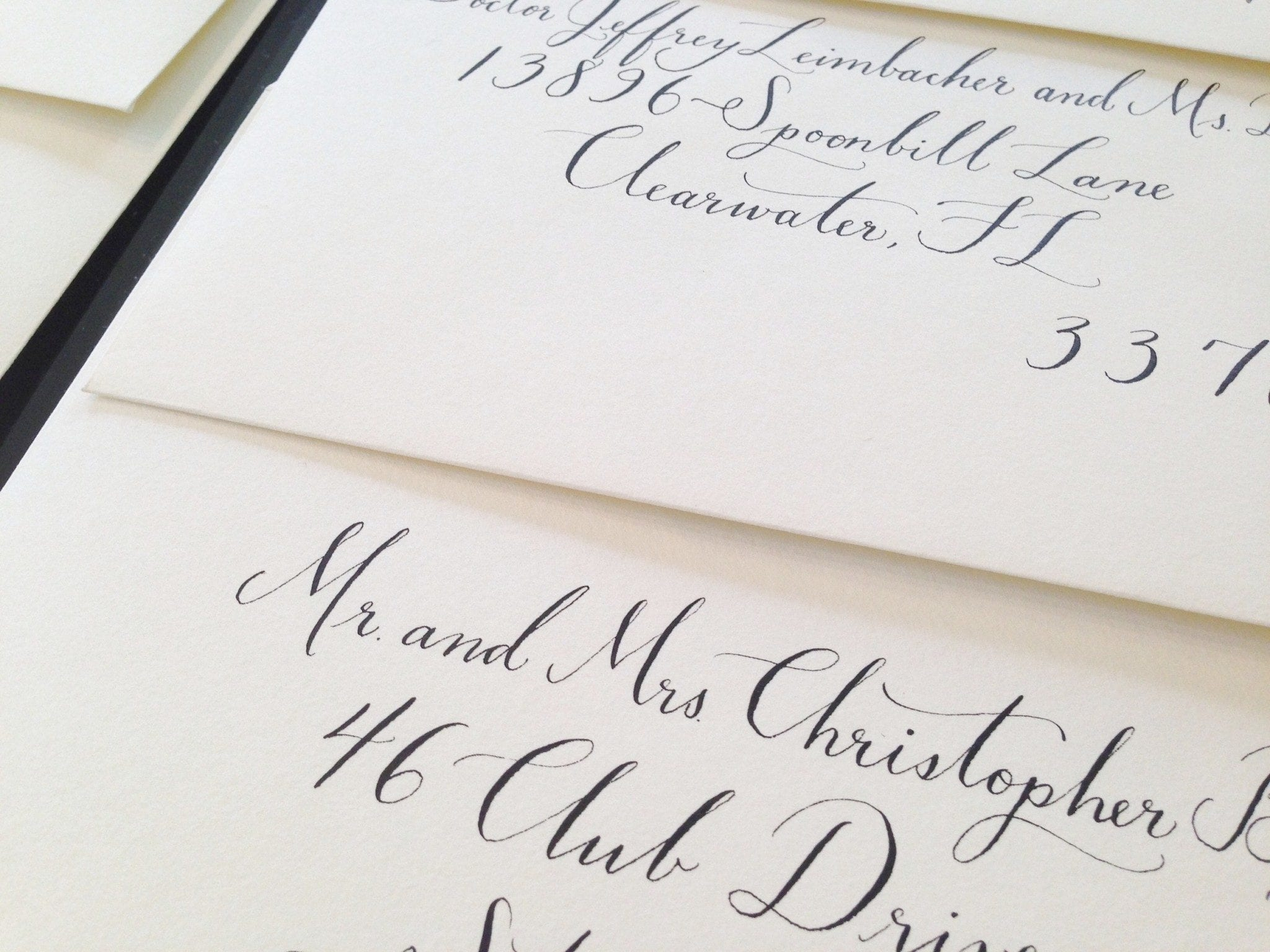 Traditional dipped pen calligraphy in black ink
