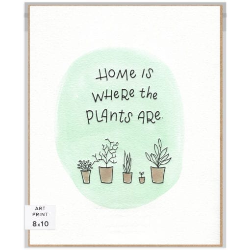 "Handlettered words ""Home is where the plants are"" letterpress-printed in black with various hand-drawn plants in pots below. Supported by a unique green watercolor background."